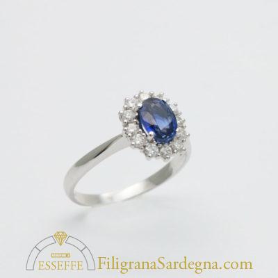 Anello con zaffiro e diamanti (ct. 0,97) 1