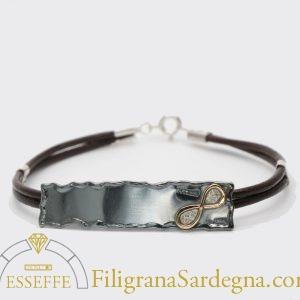 Bracciale con lastra brunita e ionfinito in or