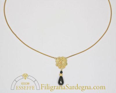 Collana con fiore in filigrana e goccia di onice pendente 1
